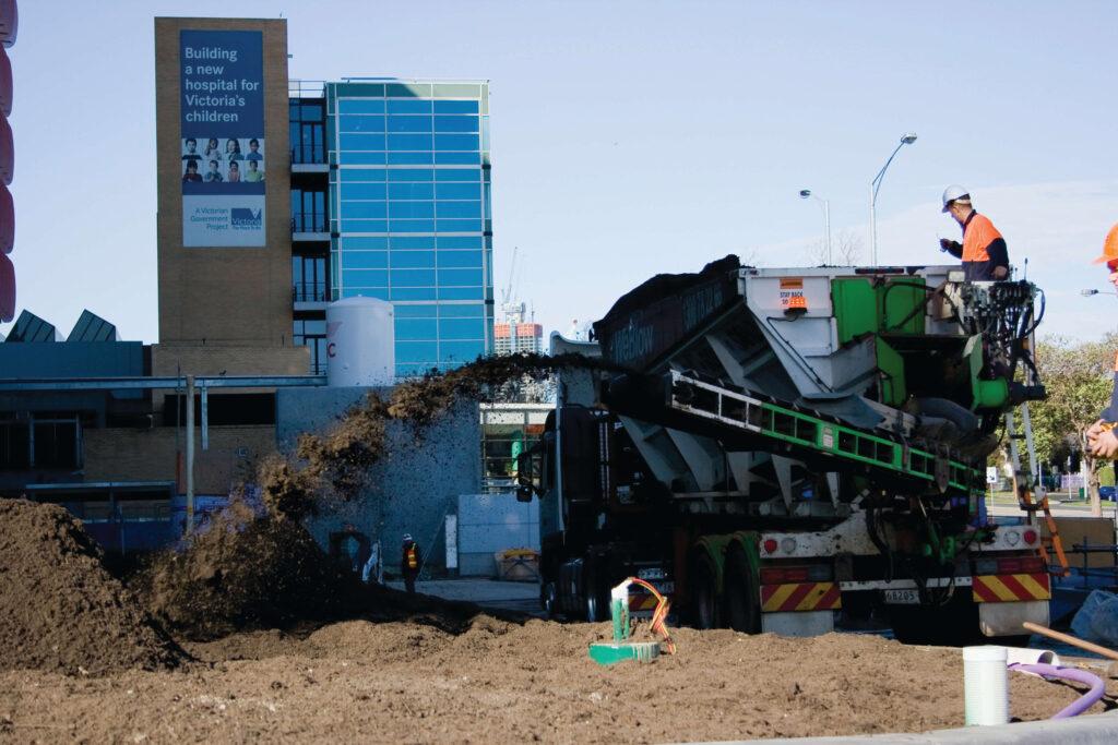 Slinger-truck-soil-install-building-site
